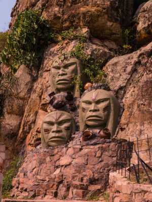 Tres Caras de Indios Monument in Tobatí, that features three large sculpted faces of the indigenous people. - Paraguay-Cosmic Travel