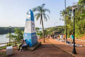 Monument in Puerto Iguazú marking the triple frontier of Argentina, Brazil and Paraguay, inscribed Hito 3 Fronteras. - Paraguay-Cosmic Travel