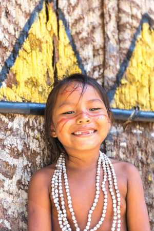 Native Brazilian girl smiling at an indigenous tribe in the Amazon. - Brésil-Cosmic Travel